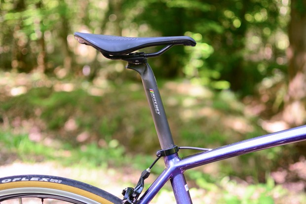 Saddle and seatpost fitted to purple road bike