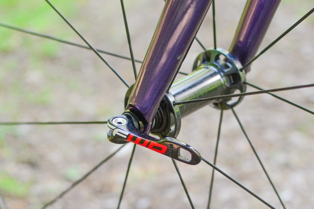 Close up of road bike front wheel showing quick-release skewer