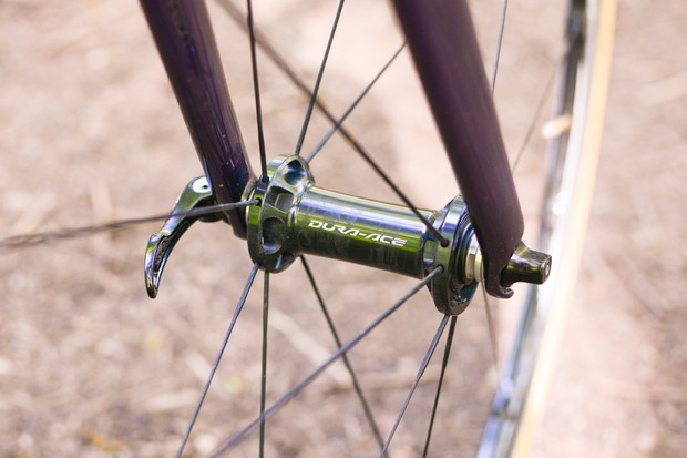 Close-up of road bike front wheel showing hub