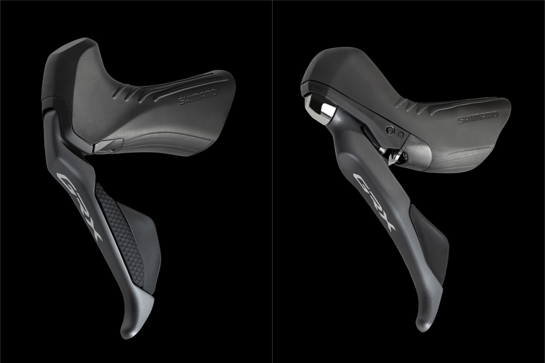 Two left-hand Shimano shift/brake levers: one Di2, one mechanical