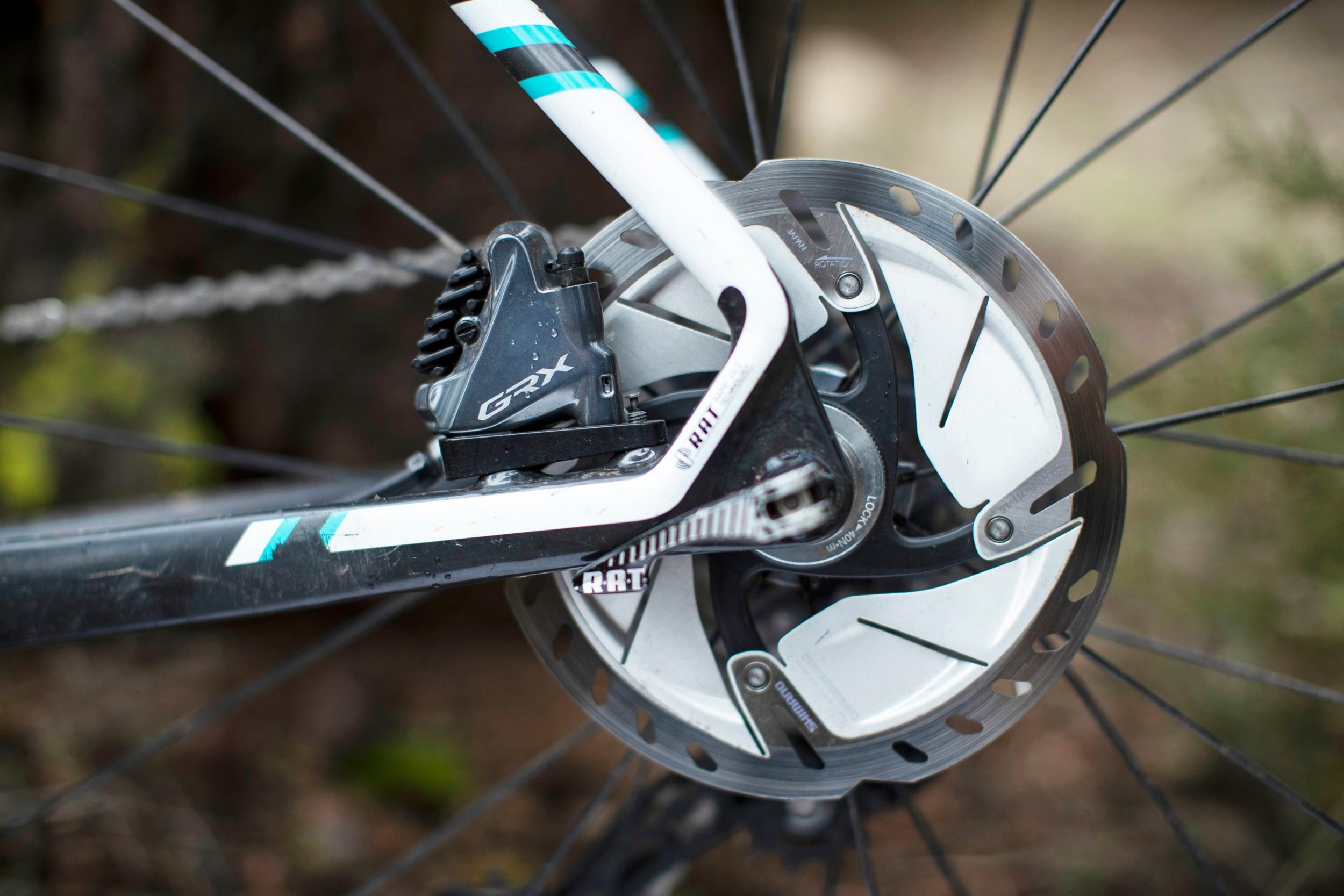 Shimano GRX disc brake caliper and disc mounted to rear of bike frame