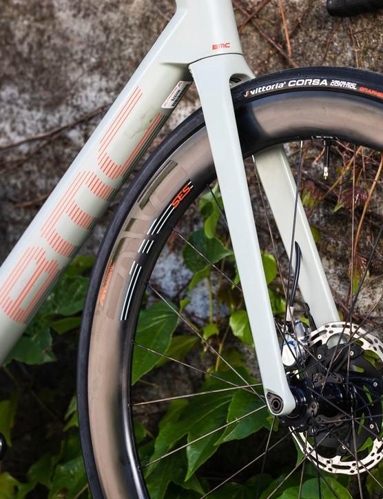 White BMC Roadmachine 01 road bike against wall