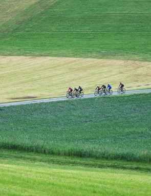 group of cyclists riding through country side