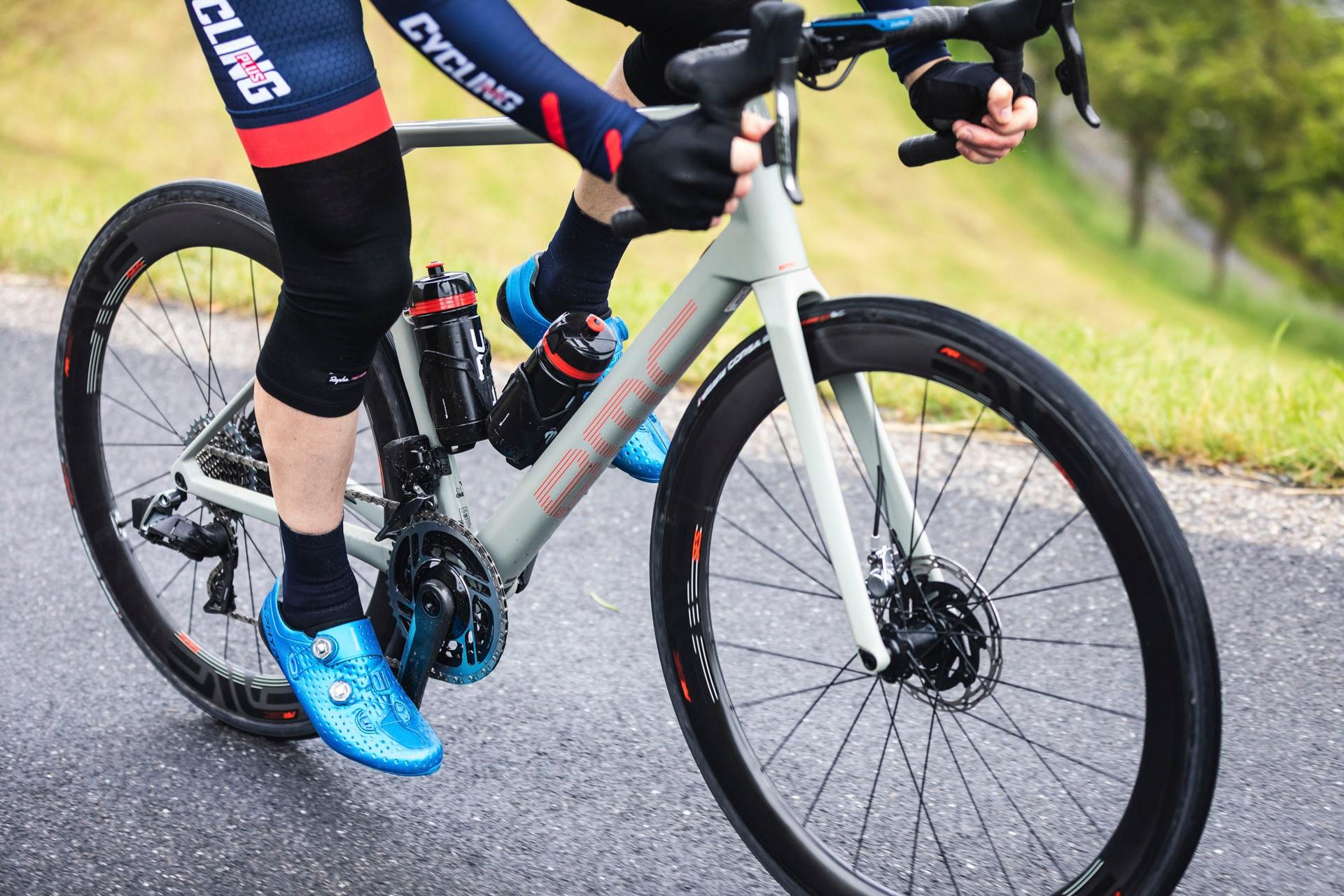 Male cyclist riding road bike