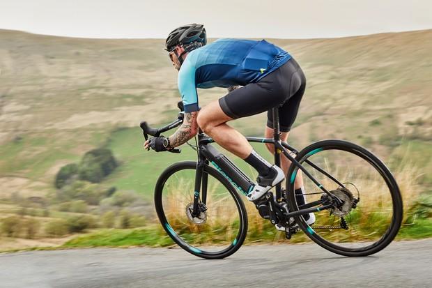 Male cyclist riding road e-bike