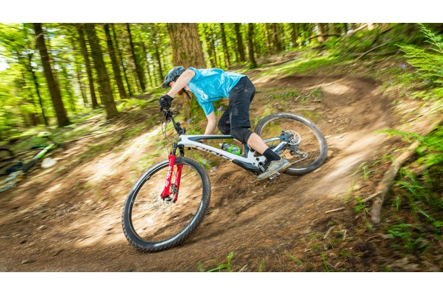 Man rides Bold Unplugged enduro mountain bike around a corner
