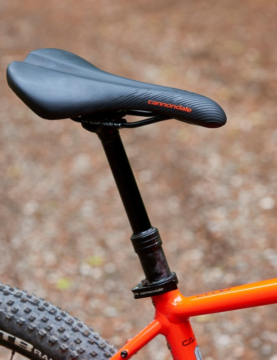 saddle on red orange hardtail mountain bike