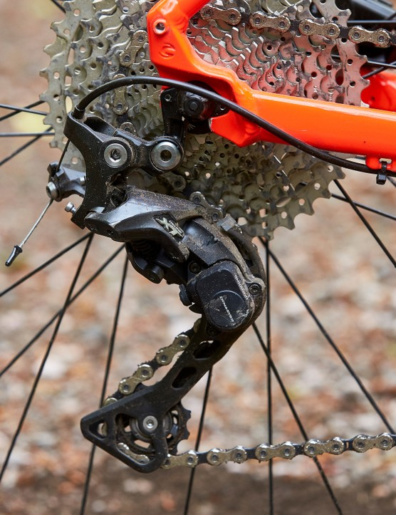 rear mech on red orange hardtail mountain bike