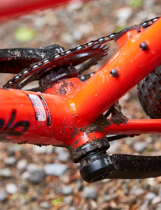 q-factore on red orange hardtail mountain bike