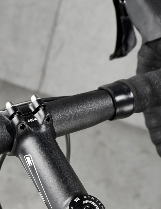 alloy handlebar on black road bike