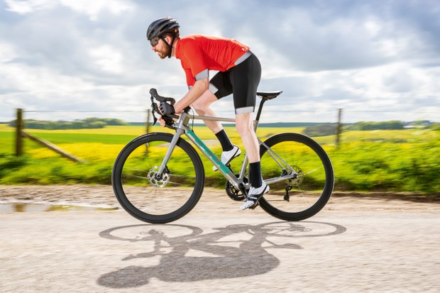 Cyclist riding grey road bike in countryside