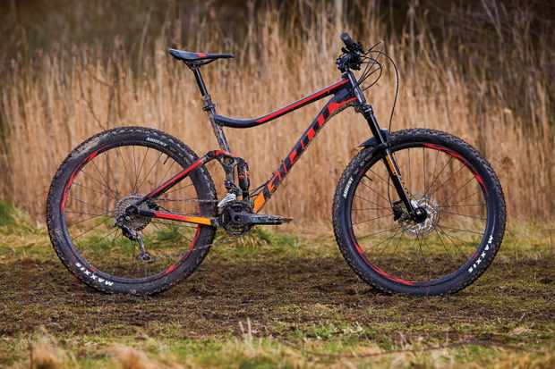 Black and red full suspension mountain bike