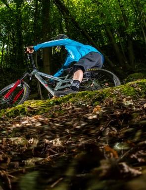 BikeRadar Technical Editor Alex Evans rides his long-term Orange Stage 6 RS enduro mountain bike around a bermed corner in the forest