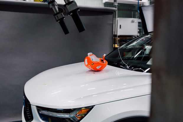POC helmet on Volvo car for crash testing
