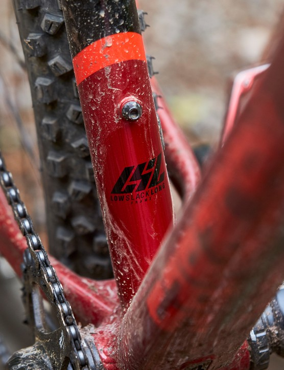 Part of frame of red and black Saracen Mantra LSL hardtail mountain bike