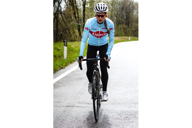 Cyclist riding black road bike down hill