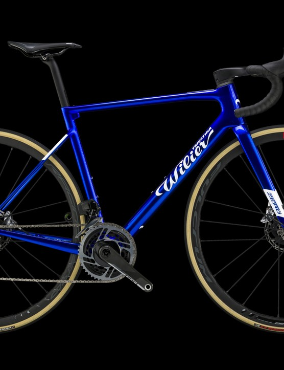 blue road bike on black background