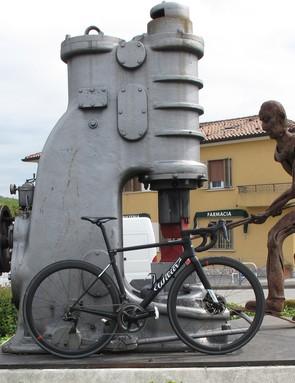 black road bike against statue