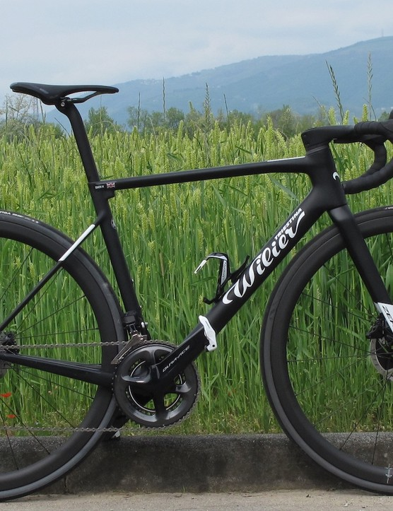 black road bike in field
