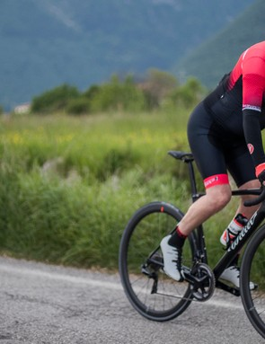 male cyclist riding black road bike
