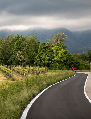 two male cyclist riding black road bike