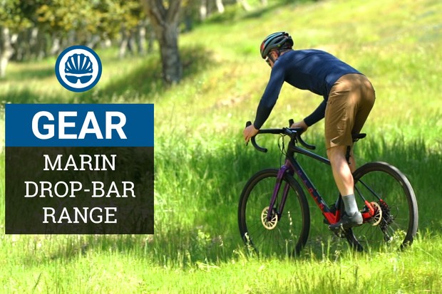 A man rides a Marin Gestalt X11 gravel bike on a sunny day over some green grass