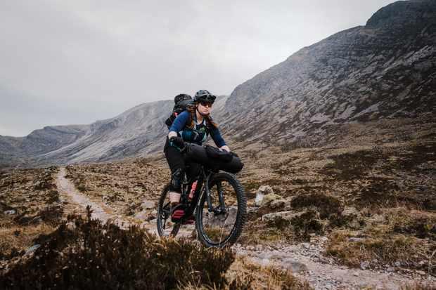 Aoife Glass riding the Liv Intrigue women's mountain bike in Torridon, Scotland