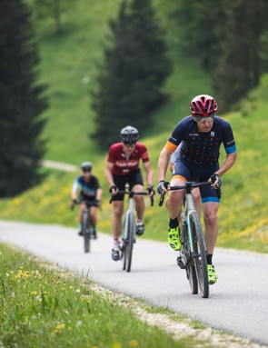 male cyclists riding grave road bikes in countryside