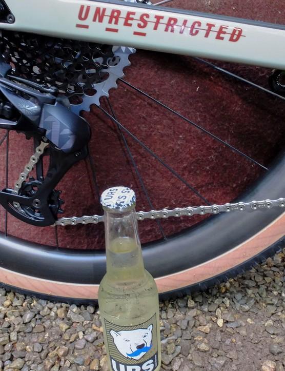 USR bottle of beer and USR gravel bike