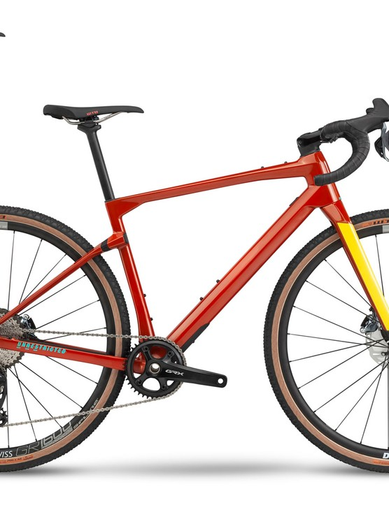 red and yellow gravel road bike white background
