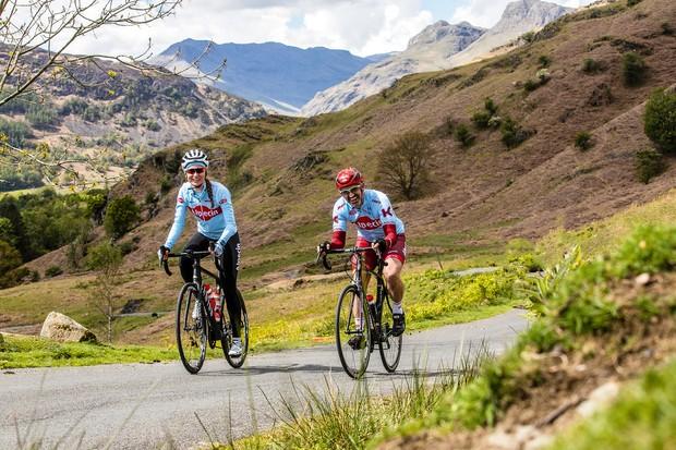 Team Alpecian cyclist riding a climb