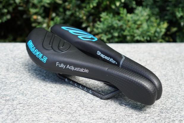 Fully adjustable bicycle saddle