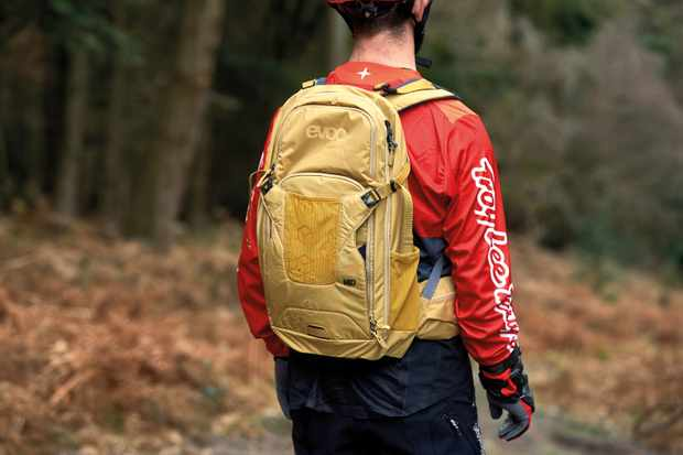 male cyclist wearing a backpack