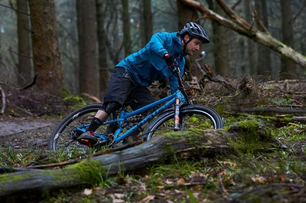 Cyclist riding mountain bike through the woods