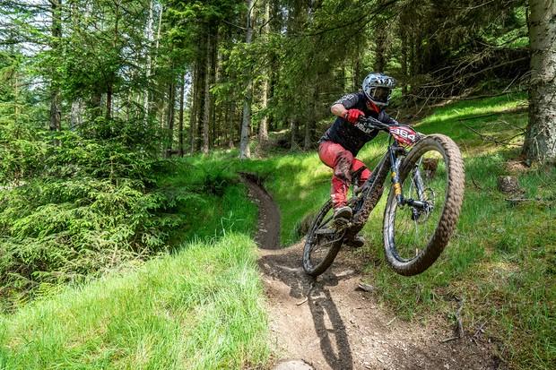 Cyclist riding mountain bike on dirt track