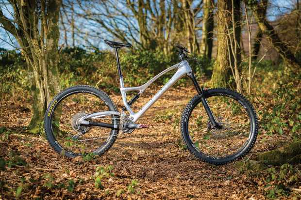Silver full-suspension mountain bike in woods