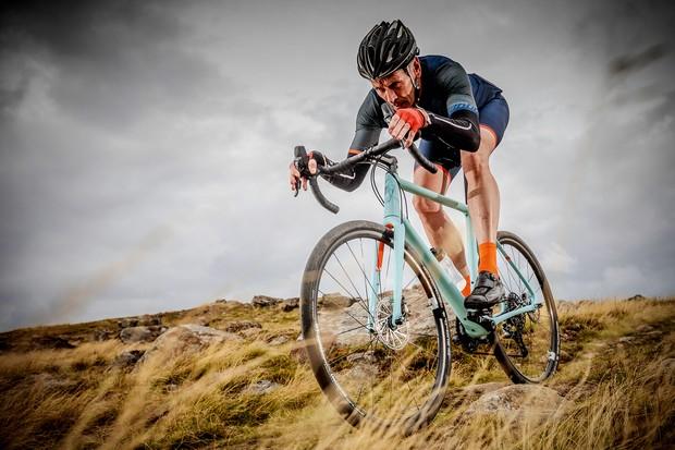 Cyclist riding Vielo V+1 gravel bike on track