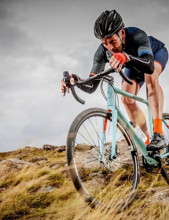 male cyclist ride gravel bike on track