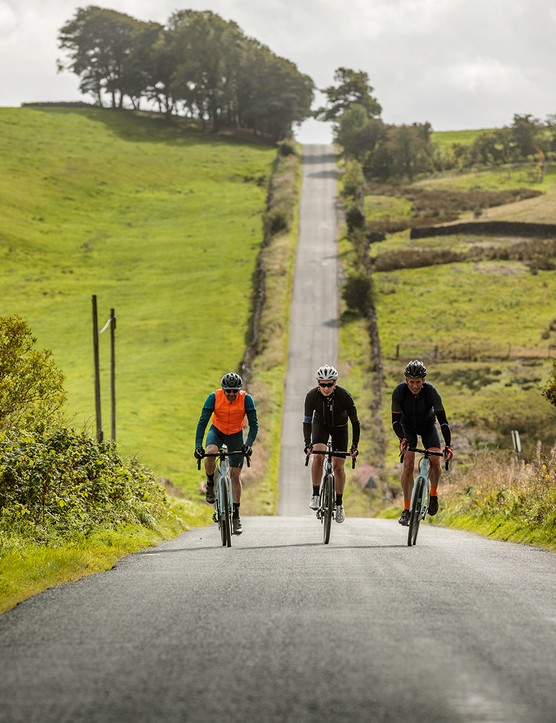 male cyclists ride gravel bike on road
