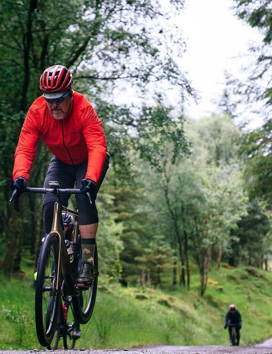 Cyclist riding gravel road bike