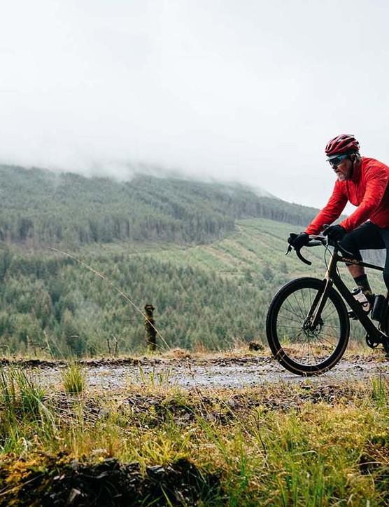 male cyclist riding gravel road bike