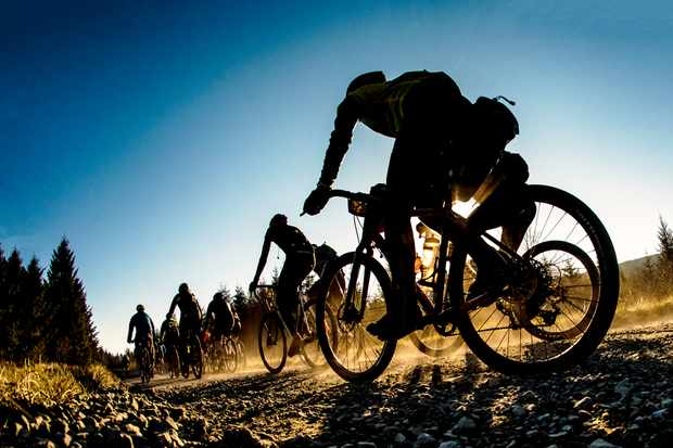 Group of cyclists riding on gravel track