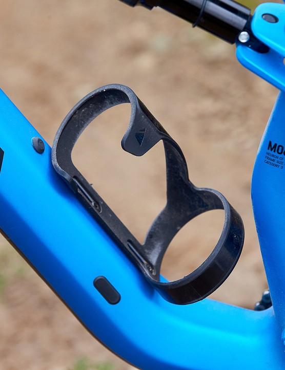 bottle cage on blue full suspension mountain bike
