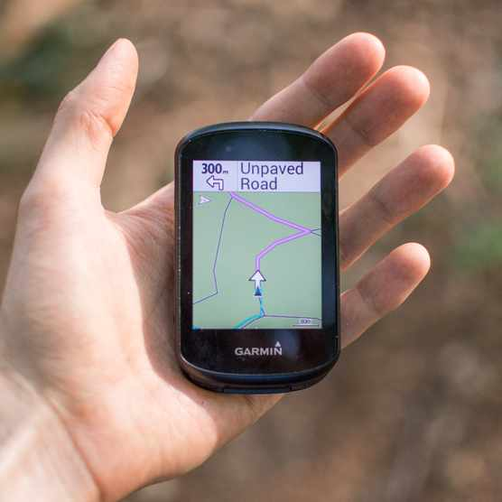 GPS bike computer on palm of hand