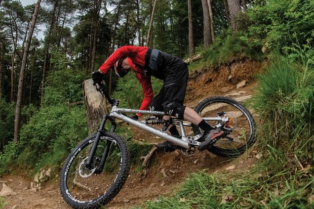 Cyclist riding mountain bikes through woodland