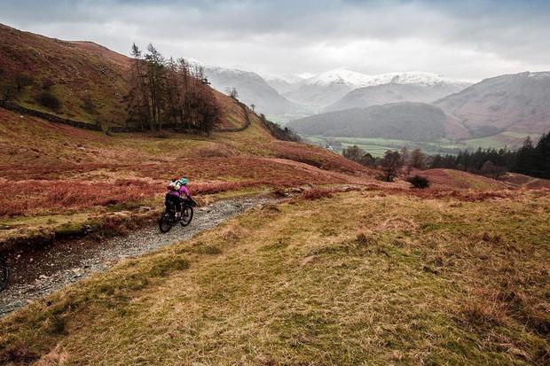 Mountain biker in hilly barren landscape