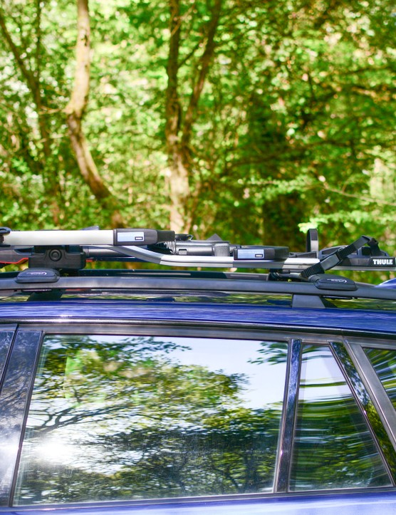 Thule UpRide bike rack folded flat on roof of car
