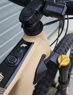 Shimano head unit on sand coloured full suspension mountain e-bike