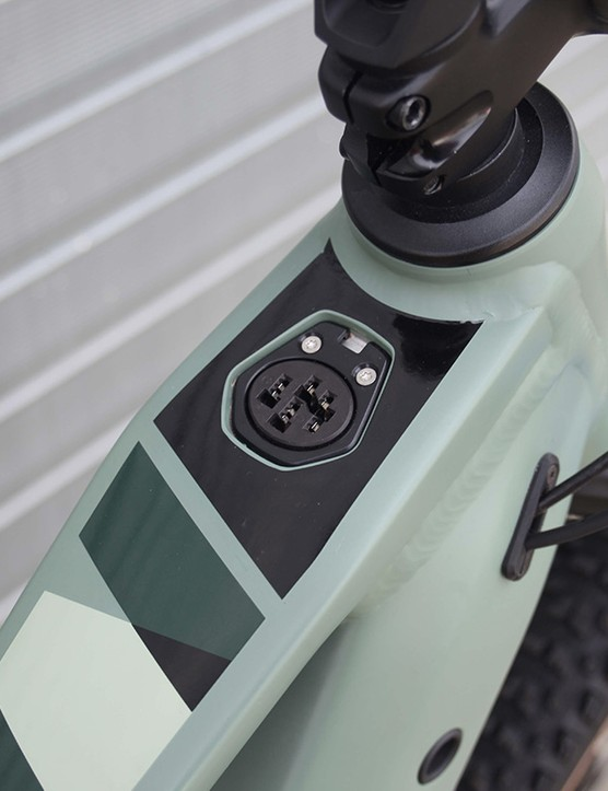 charge point on light green full suspension mountain e-bike