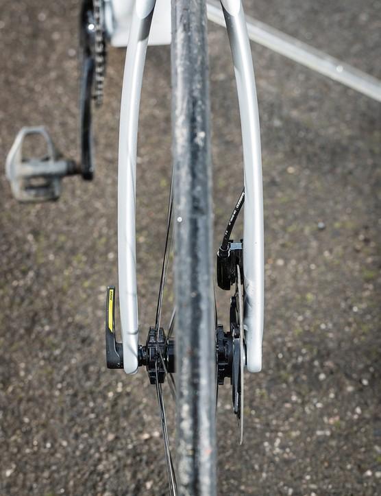 bowed fork on white orbea road bike